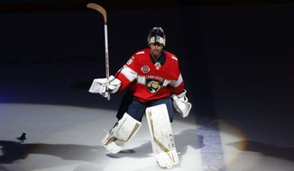 FILE - In this Feb. 23, 2019, file photo, Florida Panthers goaltender Roberto Luongo (1) skates onto the ice after being awarded the number one star of the game after an NHL hockey game against the Los Angeles Kings, in Sunrise, Fla.  Luongo has decided to retire after 19 seasons. The 40-year-old Luongo made the announcement Wednesday, June 26, 2019, on his Twitter account. (AP Photo/Joel Auerbach, File)