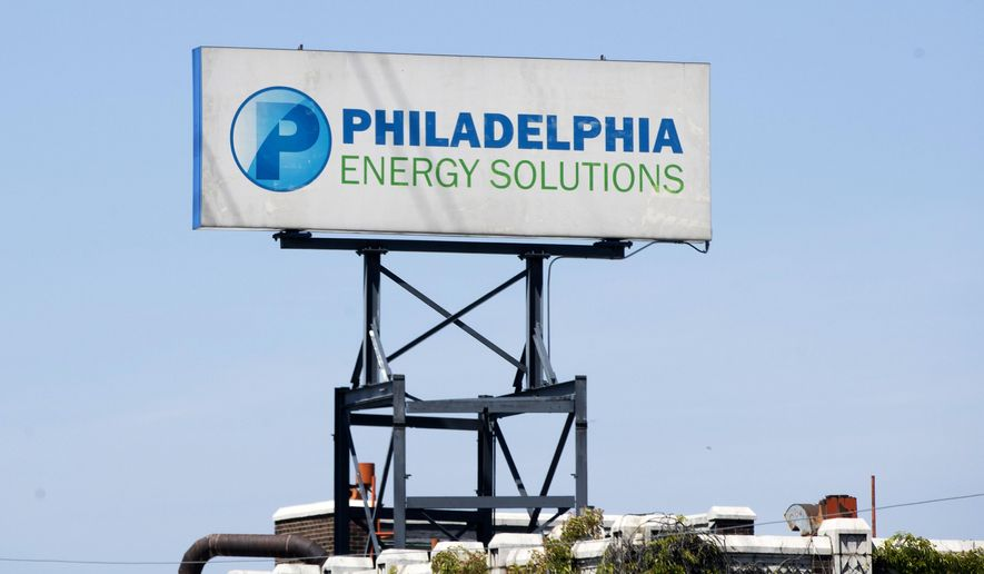 A sign for Philadelphia Energy Solutions stands at the refining complex in Philadelphia, Wednesday, June 26, 2019. The owner of the largest oil refinery complex on the East Coast is telling officials that it will close the facility after a fire last week set off explosions and damaged the facility. Philadelphia Mayor Jim Kenney said in a statement Wednesday that Philadelphia Energy Solutions had informed him of its decision to shut down the facility in the next month. The more than 1,000 workers there will be impacted, the mayor said. (AP Photo/Matt Rourke)
