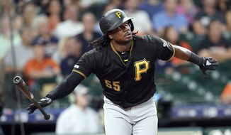 Pittsburgh Pirates' Josh Bell drops his bat after hitting a two-run home run against the Houston Astros during the first inning of a baseball game Wednesday, June 26, 2019, in Houston. (AP Photo/David J. Phillip)