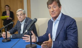 Private equity mogul Stephen Bronfman speaks to the media about the prospect of Major League Baseball returning to Montreal Wednesday, June 26, 2019, in Montreal. Bronfman, whose father Charles was the original owner of the Expos, is part of a group spearheading effort to return baseball to Montreal. At left is and Pierre Boivin. (Ryan Remiorz/The Canadian Press via AP)