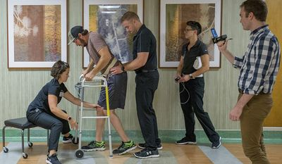 9. Mayo Clinic  Industry: Healthcare and social  Employees: 63,078    Jered Chinnock walks down a clinic hallway with his therapy team at the Mayo Clinic in Rochester, Minn. on Sept. 18, 2018. Chinnock, paralyzed since 2013, is taking steps again thanks to an electrical implant that zaps his injured spine and months of intense rehab as part of a medical study at the clinic. From left are physical therapist Megan Gill, Chinnock, kinesiologists Daniel Veith and Margaux Linde, and doctoral candidate Jonathan Calvert. (AP Photo/Teresa Crawford)