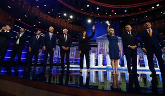 Democratic presidential candidates from left, former Colorado Gov. John Hickenlooper, entrepreneur Andrew Yang, South Bend Mayor Pete Buttigieg, former Vice-President Joe Biden, Sen. Bernie Sanders, I-Vt., Sen. Kamala Harris, D-Calif., Sen. Kristen Gillibrand, D-N.Y., former Colorado Sen. Michael Bennet and Rep. Eric Swalwell, D-Calif., wave as they enter the stage for the second night of the Democratic primary debate hosted by NBC News at the Adrienne Arsht Center for the Performing Arts, Thursday, June 27, 2019, in Miami. (AP Photo/Brynn Anderson)