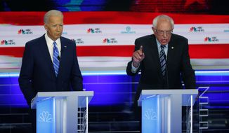 Democratic presidential candidate Sen. Bernie Sanders, I-Vt., right, speaks during the Democratic primary debate hosted by NBC News at the Adrienne Arsht Center for the Performing Arts, Thursday, June 27, 2019, in Miami, as former vice president Joe Biden listens. (AP Photo/Wilfredo Lee)
