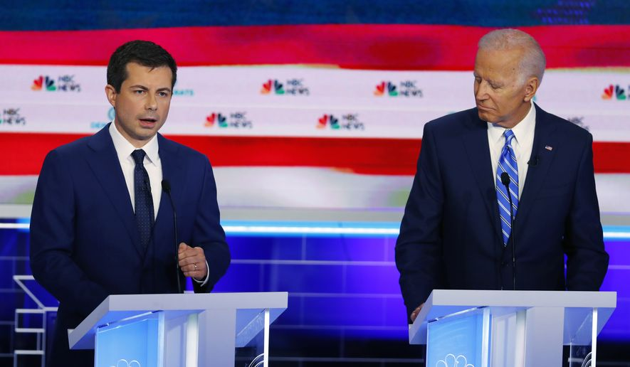 Democratic presidential candidate South Bend Mayor Pete Buttigieg, left, speaks during the Democratic primary debate hosted by NBC News at the Adrienne Arsht Center for the Performing Arts, Thursday, June 27, 2019, in Miami, as former vice president Joe Biden. (AP Photo/Wilfredo Lee)