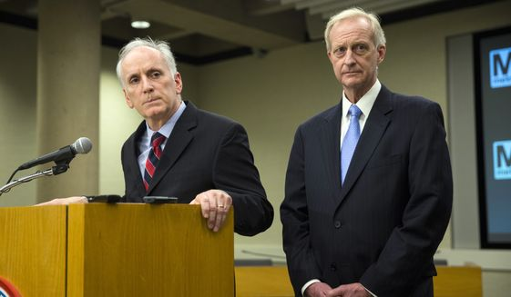 D.C. City Council Member Jack Evans, right, and Metro General Manager Paul Wiedefeld listen to a question during a news conference in this March 2016 file photo. On Aug. 8, 2019, Mr. Evans agreed to a consent settlement with the city's ethics board to resolve its concerns about his reprimand by the council for his use of official resources to conduct personal business. (AP Photo/Evan Vucci) ** FILE **