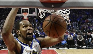 In this April 21, 2019, file photo, Golden State Warriors forward Kevin Durant, top, dunks as Los Angeles Clippers guard Landry Shamet defends during the second half in Game 4 of a first-round NBA basketball playoff series in Los Angeles. Rarely relevant at the same time on the basketball court, the Knicks and Nets are front and center in the free agency race, two of the teams best positioned to make a splash when the market opens.Both can afford two top players, with hopes of landing not only a Kevin Durant or Kyrie Irving, but possibly even both. (AP Photo/Mark J. Terrill, File) **FILE**