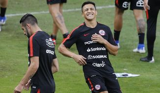 Chile's Alexis Sanchez grimaces during a training session in Sao Paulo, Brazil, Wednesday, June 26, 2019. Chile will face Colombia on June 28 for the quarterfinals for the Copa America. (AP Photo/Victor R. Caivano)
