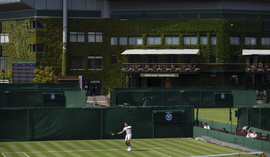 Roger Federer of Switzerland hits a ball during training session at the All England Lawn Tennis Championships in Wimbledon, London, on Wednesday, June 26, 2019. The Wimbledon Tennis Championships 2019 will be held in London from  July 1 to July 14. (Peter Klaunzer/Keystone via AP)