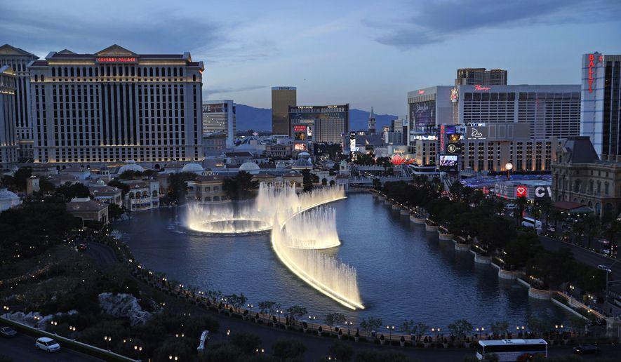 In this April 4, 2017, photo, the fountains of Bellagio erupt along the Las Vegas Strip in Las Vegas. (AP Photo/John Locher) **FILE**