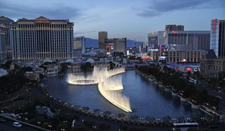 In this April 4, 2017, photo, the fountains of Bellagio erupt along the Las Vegas Strip in Las Vegas. (AP Photo/John Locher) **FILE**