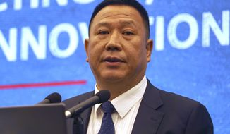 """Huawei's Chief Legal Officer Song Liuping speaks at a press conference at the company's headquarters in Shenzhen in southern China's Guangdong province, Thursday, June 27, 2019. Chinese tech giant Huawei has warned a U.S. proposal to block the company from pursuing damages in the country's patent courts would be a """"catastrophe for global innovation."""" (AP Photo/Dake Kang)"""