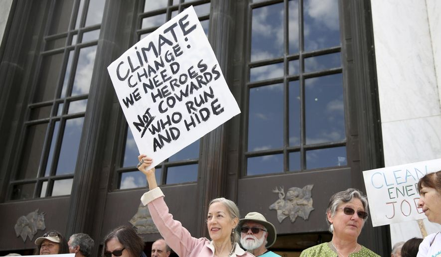Allyson Miller, of Salem, attends a rally in support of HB 2020, a greenhouse gas emissions cap-and-trade bill, and demand Republican Senators return to the Legislature at the Oregon State Capitol in Salem, Ore., Tuesday, June 25, 2019. (Anna Reed/Statesman-Journal via AP)