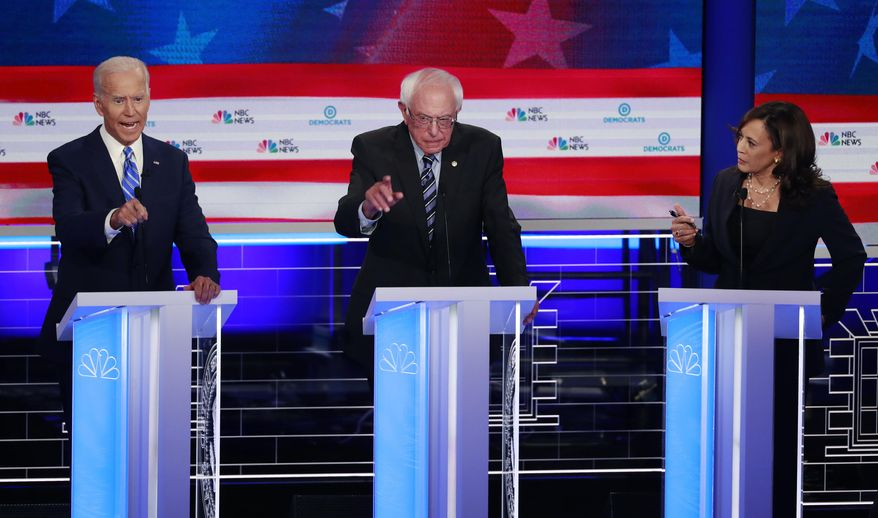 Democratic presidential candidate former vice president Joe Biden, left, Sen. Bernie Sanders, I-Vt., and Sen. Kamala Harris, D-Calif., all talk at the same time during the Democratic primary debate hosted by NBC News at the Adrienne Arsht Center for the Performing Arts, Thursday, June 27, 2019, in Miami. (AP Photo/Wilfredo Lee) **FILE**