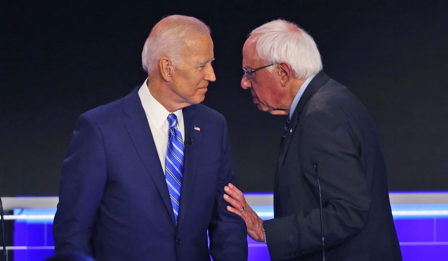 Democratic presidential candidate Sen. Bernie Sanders, I-Vt.., speaks to former Vice President Joe Biden during a break in the Democratic primary debate hosted by NBC News at the Adrienne Arsht Center for the Performing Arts, Thursday, June 27, 2019, in Miami. (AP Photo/Wilfredo Lee) ** FILE **