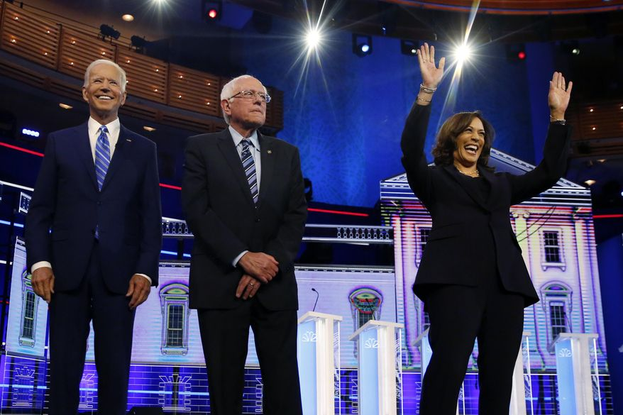 Democratic presidential candidates former vice president Joe Biden, left, Sen. Bernie Sanders, I-Vt., and Sen. Kamala Harris, D-Calif., right, stand on stage for a photo op before the start of the the Democratic primary debate hosted by NBC News at the Adrienne Arsht Center for the Performing Arts, Wednesday, June 27, 2019, in Miami. (AP Photo/Wilfredo Lee) ** FILE **