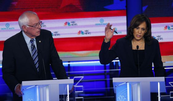 Democratic presidential candidate Sen. Kamala Harris, D-Calif., right, speaks during the Democratic primary debate hosted by NBC News at the Adrienne Arsht Center for the Performing Arts, Thursday, June 27, 2019, in Miami, as Sen. Bernie Sanders, I-Vt., listens. (AP Photo/Wilfredo Lee) ** FILE **