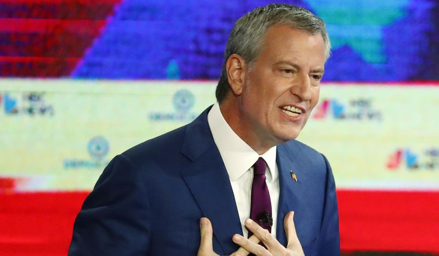 Democratic presidential candidate New York City Mayor Bill de Blasio gestures during a Democratic primary debate hosted by NBC News at the Adrienne Arsht Center for the Performing Art, Wednesday, June 26, 2019, in Miami. (AP Photo/Wilfredo Lee)