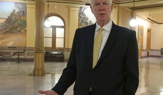 """Dave Lindstrom, a Republican candidate for the U.S. Senate in Kansas, discusses his campaign during an Associated Press interview, Wednesday, June 26, 2019, inside the Kansas Statehouse rotunda in Topeka, Kan. Lindstrom, a former Kansas City Chiefs player, says he is running partly because he's worried about what he sees as a growing embrace of socialism and, """"I think our country's under attack."""" (AP Photo/John Hanna)"""