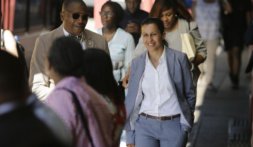 Queens district attorney candidate Tiffany Caban walks among commuters Wednesday, June 26, 2019, in the Queens borough of New York. With 99 percent of precincts reporting, Caban led Melinda Katz by 1,090 votes, out of more than 85,000 votes counted. Election officials won't start counting absentee ballots until Monday. (AP Photo/Frank Franklin II)