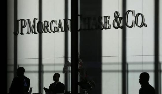This Oct. 21, 2013, file photo shows the JPMorgan Chase & Co. logo displayed at their headquarters in New York. (AP Photo/Seth Wenig, File)
