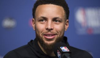 FILE - In this May 29, 2019 file photo, Golden State Warriors basketball guard Stephen Curry speaks to the media before practice for the NBA Finals against the Toronto Raptors in Toronto. The Golden State Warriors superstar is strategically producing content that focuses on sports, family and faith through Unanimous Media, which he co-founded with Jeron Smith and Erick Peyton. The newly-formed production company already has several projects under its belt including a major studio film, network television show and a couple documentaries in just a year. (Nathan Denette/The Canadian Press via AP, File)