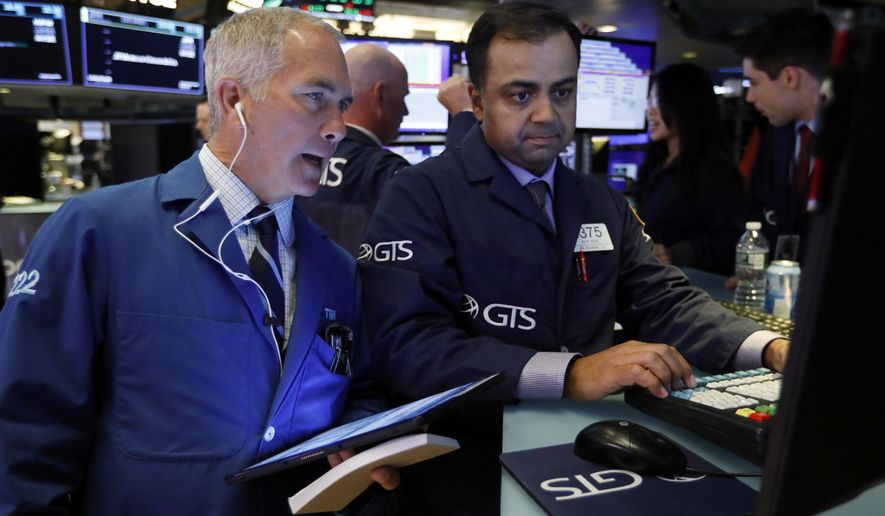 FILE - In this June 11, 2019, file photo trader Timothy Nick, left, and specialist Dilip Patel work on the floor of the New York Stock Exchange. The U.S. stock market opens at 9:30 a.m. EDT on Thursday, June 27. (AP Photo/Richard Drew, File)