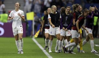 England's Lucy Bronze, left, celebrates with teammates after scoring her team's third goal during the Women's World Cup quarterfinal soccer match between Norway and England at Oceane Stadium in Le Havre, France, Thursday, June 27, 2019. (AP Photo/Alessandra Tarantino)