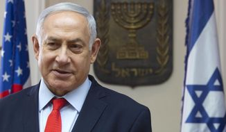 """Israeli Prime Minister Benjamin Netanyahu speaks at the Prime Minister's office in Jerusalem, Thursday, June 20, 2019. Netanyahu is calling for """"all peace-loving countries"""" to stand by the United States' efforts to curb Iranian aggression. (AP Photo/Sebastian Scheiner)"""
