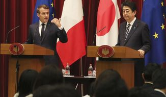 French President Emmanuel Macron, left, speaks as Japanese Prime Minister Shinzo Abe listens during their joint press conference at Abe's official residence in Tokyo, Wednesday, June 26, 2019. (AP Photo/Koji Sasahara,pool)
