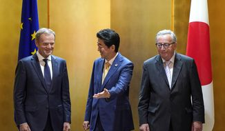 European Commission President Jean-Claude Juncker, right, and European Council President Donald Tusk, left, are escorted by Japanese Prime Minister Shinzo Abe prior to their working lunch on the sidelines of the G20 Summit at the International Exhibition Center in Osaka, Japan, Thursday, June 27, 2019. (Franck Robichon/Pool Photo via AP)