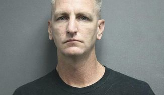 This photo provided by the Seagoville Police Department shows Michael Damien Dunn. The Texas police officer has been arrested on a murder charge after he fatally shot the driver of a truck reported stolen from a Dallas suburb earlier in June. The Farmers Branch Officer, Dunn, turned himself in Wednesday night, June 26, 2019, after a grand jury indicted him for murder in the killing of 35-year-old Juan Moreno, officials said Thursday. The internal investigation of Dunn's actions is ongoing and the Farmers Branch department is awaiting information from Dallas police, who conducted the criminal investigation of the shooting, Farmers Branch Police Chief David Hale said in a statement. (Seagoville Police Department via AP)