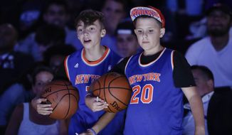 Young New York Knicks fans react during the NBA basketball draft Thursday, June 20, 2019, in New York. (AP Photo/Julio Cortez) ** FILE **