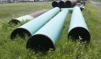 FILE - In this June 29, 2018, file photo, pipeline used to carry crude oil is shown at the Superior terminal of Enbridge Energy in Superior, Wis. The Wisconsin Supreme Court ruled Thursday, June 27, 2019, that Canada-based Enbridge Energy doesn't need to carry additional insurance for a pipeline project in Dane County, despite the local government's insistence that it do so in case of an accidental spill. (AP Photo/Jim Mone, File)