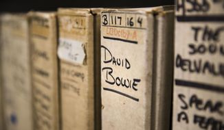 """In this May 8, 2019 photo show is a reel from David Bowie's recording sessions at the Sigma Sound Studio while getting together his 1974 """"Young Americans"""" album, at Drexel University in Philadelphia. A college music department has helped resurrect the music of a largely forgotten Philadelphia funk band and is hoping to discover more gems in its archives. Going through thousands of donated tapes, a band called the Nat Turner Rebellion jumped out to listeners at Drexel University. They assembled """"Laugh to Keep From Crying,"""" the band's debut album. It was recently released some 50 years after it was recorded at Sigma Sound, the studio which helped create the so-called """"Sound of Philadelphia."""" (AP Photo/Matt Rourke)"""