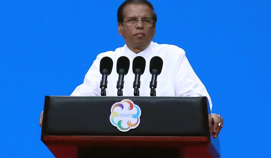 FILE - In this May 15, 2019, file photo, Sri Lanka President Maithripala Sirisena delivers a speech during the opening ceremony of the Conference on Dialogue of Asian Civilizations in Beijing, China. Siriserna says he has ordered the executions of four drug offenders who will be hanged in prison soon. The executions if carried out will end a 43-year moratorium on capital punishment in the Indian Ocean island nation. (How Hwee Young/Pool Photo via AP, File)