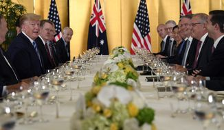 President Donald Trump, second from left, attends dinner with Australian Prime Minister Scott Morrison, second from right, in Osaka, Japan, Thursday, June 27, 2019. Trump and Morrison are in Osaka to attend the G20 summit. (AP Photo/Susan Walsh)