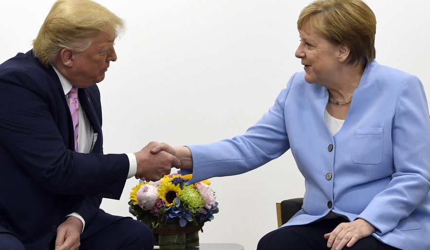 President Donald Trump meets with German Chancellor Angela Merkel during a meeting on the sidelines of the G-20 summit in Osaka, Japan, Friday, June 28, 2019. (AP Photo/Susan Walsh)