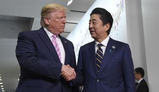 President Donald Trump shakes with Japanese Prime Minister Shinzo Abe during a meeting on the sidelines of the G-20 summit in Osaka, Japan, Friday, June 28, 2019. (AP Photo/Susan Walsh)