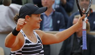 FILE - In this June 8, 2019, file photo, Australia's Ashleigh Barty celebrates after winning her women's final match of the French Open tennis tournament against Marketa Vondrousova, of the Czech Republic, at the Stade Roland Garros in Paris. Barty will be competing in the 2019 Wimbledon tournament.(AP Photo/Michel Euler, File)