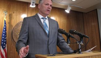 Alaska Gov. Mike Dunleavy speaks to reporters about his budget vetoes at the state Capitol in Juneau, Alaska Friday, June 28, 2019. The university system, health and social service programs and public broadcasting were among the areas affected by vetoes. The budget agreed to by the House and Senate cut state support for the university system by a fraction of what Dunleavy proposed. Lawmakers have the ability to override budget vetoes if they can muster sufficient support. (AP Photo/Becky Bohrer)