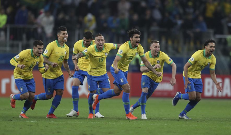 Brazil's soccer players celebrate winning at the end of the Copa America quarterfinal soccer match against Paraguay at the Arena do Gremio in Porto Alegre, Brazil, Thursday, June 27, 2019. (AP Photo/Natacha Pisarenko)