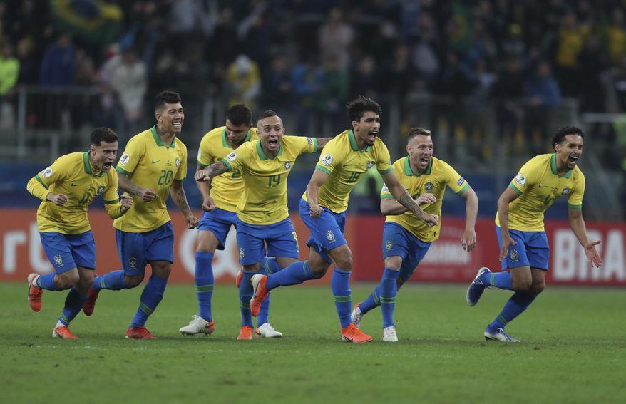 Brazil's soccer players celebrate winning at the end of the Copa America quarterfinal soccer match against Paraguay at the Arena do Gremio in Porto Alegre, Brazil, Thursday, June 27, 2019. (AP Photo/Natacha Pisarenko)