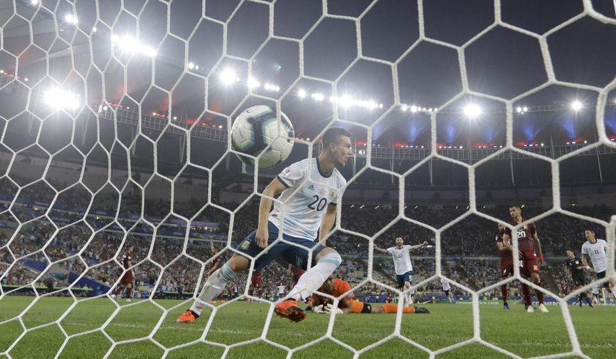Argentina's Giovani Lo Celso scores his side's second goal against Venezuela during a Copa America quarterfinal soccer match at the Maracana stadium in Rio de Janeiro, Brazil, Friday, June 28, 2019. (AP Photo/Leo Correa)