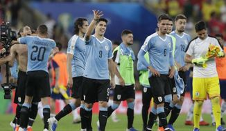 Uruguay's Luis Suarez (9) and teammates acknowledge the fans at the end of a Copa America Group C soccer match against Chile at the Maracana stadium in Rio de Janeiro, Brazil, Monday, June 24, 2019. (AP Photo/Silvia Izquierdo)