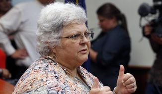 Susan Bro, mother of Heather Heyer who was killed in 2017 during a white supremacist rally, gives a thumbs up to the press after the sentencing of James Alex Fields Jr. in federal court in Charlottesville, Va., Friday, June 28, 2019. Fields was sentenced to life in prison for his role in a car attack during a white supremacist rally in 2017. Bro gave a thumbs up to the press for their coverage of the tragedy. (AP Photo/Steve Helber)