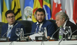 IDENTIFIES DANY BAHAR AS AN ECONOMIST AND NOT AS AN OPPOSITION LEADER -  Economist Dany Bahar, left, Venezuelan opposition leader David Smolansky, center, and Secretary General of the Organization of American States Luis Almagro, attend a session regarding the situation of Venezuelan migrants, during the 49th OAS General Assembly in Medellin, Colombia, Friday, June 28, 2019. The OAS meeting is expected to focus on Venezuela's crisis, including the impact from an exodus of Venezuelans into neighboring nations. The regional body is also expected to take diplomatic measures to pressure the Nicolas Maduro government to accept free elections with international monitoring.(AP Photo/Luis Benavides)