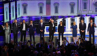 Democratic presidential candidates from left, author Marianne Williamson, former Colorado Gov. John Hickenlooper, entrepreneur Andrew Yang, South Bend Mayor Pete Buttigieg, former Vice-President Joe Biden, Sen. Bernie Sanders, I-Vt., Sen. Kamala Harris, D-Calif., Sen. Kirsten Gillibrand, D-N.Y., Colorado Sen. Michael Bennet and Rep. Eric Swalwell, D-Calif., wave as they enter the stage for the second night of the Democratic primary debate hosted by NBC News at the Adrienne Arsht Center for the Performing Arts, Thursday, June 27, 2019, in Miami. (AP Photo/Wilfredo Lee)