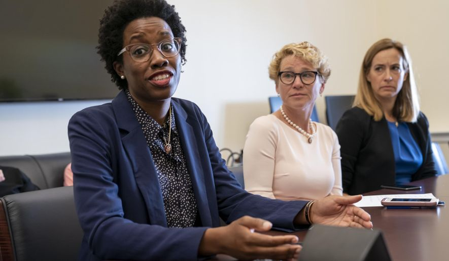 From left, Rep. Lauren Underwood, D-Ill., Rep. Chrissy Houlahan, D-Pa., and Rep. Mikie Sherrill, D-N.J., part of a small group of freshman representatives calling themselves Task Force Sentry, gather for an interview with The Associated Press to discuss their focus on election security, on Capitol Hill in Washington, Thursday, June 27, 2019. (AP Photo/J. Scott Applewhite)