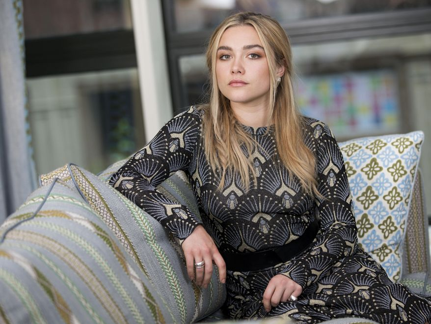 """This June 18, 2019 photo shows actress Florence Pugh posing for a portrait at the Crosby Street Hotel in New York to promote her film """"Midsommar."""" (Photo by Brian Ach/Invision/AP)"""