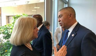 U.S. Rep. William Lacy Clay speaks with St. Louis Mayor Lyda Krewson after a news conference on Friday, June 28, 2019, at St. Louis Children's Hospital in St. Louis. Clay, a Democrat, discussed a bill he co-sponsored with U.S. Rep. Robin Kelly, D-Illinois, that would allow cities to enact stronger gun laws than their states. Clay said that 43 states currently prohibit cities from enacting stricter gun laws. (AP Photo by Jim Salter)